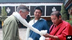 Ambassador Huntsman receives a scarf in a traditional Tibetan welcome at Jokhang Temple.