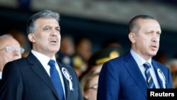 FILE - Turkey's President Abdullah Gul (L) is pictured with Prime Minister Recep Tayyip Erdogan.