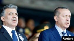 FILE - Turkey's President Abdullah Gul (L) and Prime Minister Recep Tayyip Erdogan