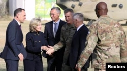 U.S. Defense Secretary James Mattis, second from right, and NATO Secretary General Jens Stoltenberg, center, are welcomed by U.S. General John Nicholson after arriving at Resolute Support Mission headquarters in Kabul, Afghanistan, Sept. 27, 2017.