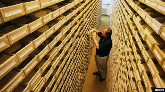 Udo Jost of the International Tracing Service (ITS) is seen in the ITS archive in central German town of Bad Arolsen, May 10, 2006.