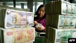 Việt Nam sẽ thực thi chính sách tiền tệ chặt chẽ trong năm 2012