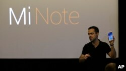 Xiaomi vice president of global operations Hugo Barra holds up a Mi Note during a presentation in San Francisco, Thursday, Feb. 12, 2015.