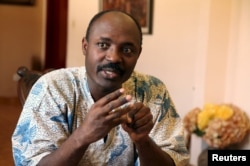 FILE - Journalist Rafael Marques de Morais is interviewed at his home in Luanda, Angola, May 12, 2015.