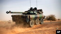 A French tank is seen heading north at the tail end of military convoy in Gao, northern Mali, Feb. 6, 2013.