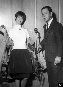 "Barbara Feldon and Don Adams played spies in the television comedy ""Get Smart."" Here they show their weapons and gadgets. (Los Angeles, 1965.)"