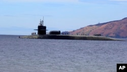 El submarino nuclear estadounidense USS Michigan es visto en esta foto de archivo al oeste de Manila, Filipinas, en 2014.