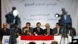Members of Syrian oppositions (L-R) Ahmed Ramadan, Khaled Hassaleh, Hassan Hashmi, Lovay Safi, Abdul Basit Sida, Adip Shishakil, Hassan Shalabi attend a news conference after meeting in Istanbul, August 23, 2011
