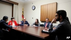 From left, Eftakhar Alam, with the Washington Islamic Society of North America; Rabbi Julie Schonfeld; Eli Epstein; Belle Yoeli and Ken Bandler, with the American Jewish Committee, meet with staff members from the office of Rep. Adriano Espaillat, D-N.Y., on Capitol Hill in Washington, Feb. 1, 2017. Bigoted rhetoric and harassment targeting both religions since the 2016 presidential election has drawn people together.