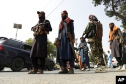 """FILE - Taliban fighters patrol in the Wazir Akbar Khan neighborhood in Kabul, Afghanistan, Aug. 18, 2021. The day before, the Taliban declared an """"amnesty"""" across Afghanistan and urged women to join their government."""