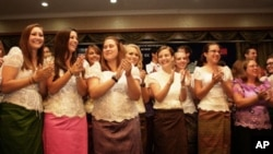 59 new Peace Corps volunteers are sworn in during a ceremony at Phnom Penh's Daegu Gyeong Buk Cultural Center on Monday, October 3, 2011.