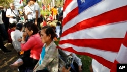 Cambodian land eviction victims wait for delivering a petition in front of U.S. Embassy to Cambodia during a rally, in Phnom Penh, Cambodia, Tuesday, Nov. 18, 2014. They demanded to release other land activists who were arrested during a protest.