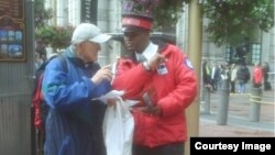 City ambassador Wayne Alexis helps a tourist find his way in San Francsico, California. (Photo courtesy Union Square BID)