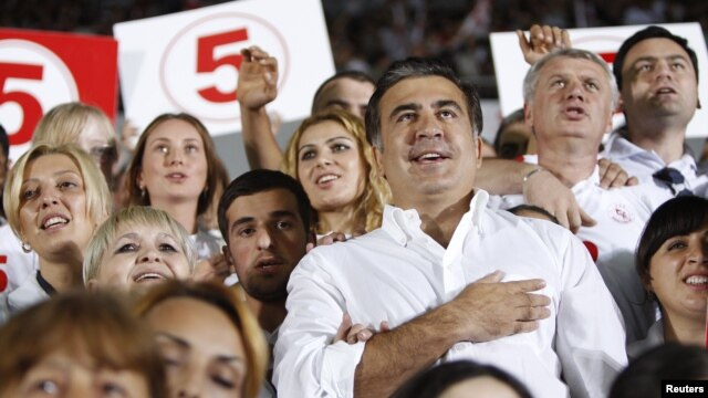 Georgia's President and leader of the ruling United National Movement party Mikheil Saakashvili gestures during the national anthem with his supporters during an election rally at a stadium in Tbilisi September 28, 2012. REUTERS/David Mdzinarishvili (GEOR