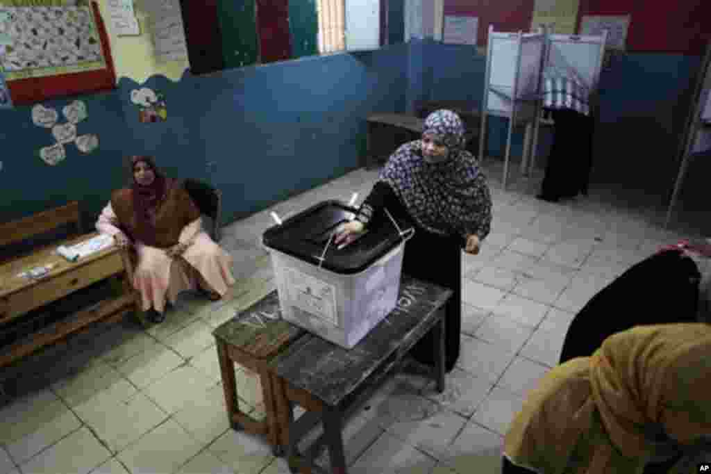 An Egyptian woman casts her vote inside a polling station in Cairo, Egypt, Thursday, May 24, 2012. In a wide-open race that will define the nation's future political course, Egyptians voted Thursday on the second day of a landmark presidential election th