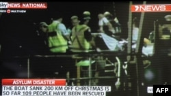 Screen grab shows asylum-seeker survivors arriving at Christmas Island after their boat capsized 120 nautical miles north of Christmas Island, 2,600 kilometres (1,600 miles) from the Australian mainland, June 22, 2012.