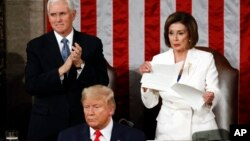 House Speaker Nancy Pelosi of Calif., tears her copy of President Donald Trump's State of the Union address after he delivered it to a joint session of Congress Feb. 4, 2020. Vice President Mike Pence is at left. (AP Photo/Patrick Semansky)