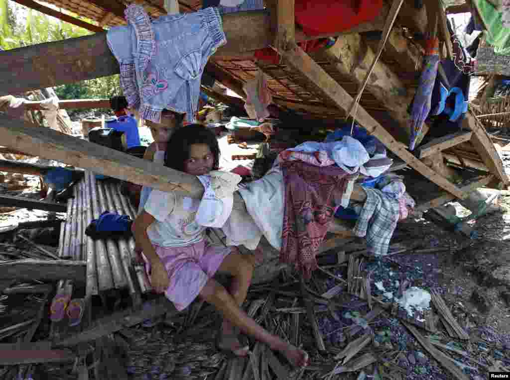 Typhoon victims stay in their house destroyed by Typhoon Hagupit in Can-avid, Samar in central Philippines, Dec. 8, 2014.