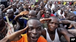 Youth supporters of Ivory Coast's Laurent Gbagbo gather at a stadium at army headquarters to sign up for military service in Abidjan, March 21, 2011