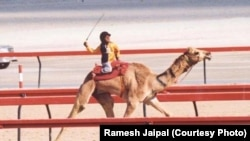 Ramesh Jaipal, who was sold into slavery as a child, is seen racing a camel in Dubai at age 6.