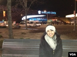 Annisa enjoying an overnight trip to New York - one way to see the country, but also to increase expenses.