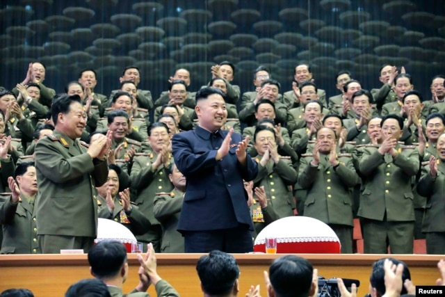 Military officials applaud with North Korean leader Kim Jong Un, during the Unhasu concert in Pyongyang, in a photo released April 16, 2013. (KCNA)