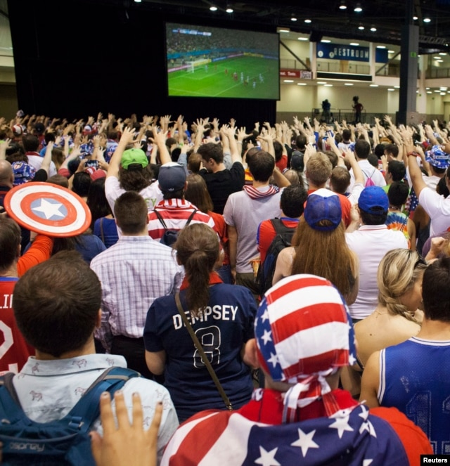 Fans watch the United States take on Belgium in their World Cup round of 16 match, at an event in Seattle, Washington, July 1, 2014.