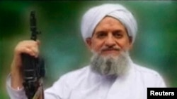 "FILE - U.S. counterterrorism officials say there's no reason to believe an audio message released by al-Qaida's Ayman al-Zawahiri, seen in an image from a video released in 2011, is ""not authentic."""