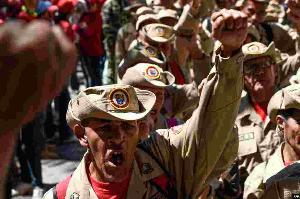 Members of Venezuela's Bolivarian militia demonstrate in support of President Nicolas Maduro during a commemoration for the '27th Anniversary of the Military Rebellion of the 4FEB92 and National Dignity Day,' at Bolivar Square in Caracas.