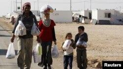 Một gia đình người tị nạn Syria tại trại tị nạn Zaatri trong thành phố Mafraq ở Jordan.