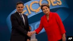 巴西舉行總統選舉投票,兩名總統候選人,現任總統迪爾馬•羅塞夫(右)和參議員阿埃西奧•內維斯(左)。