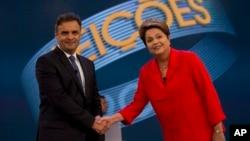 Tổng thống đương nhiệm Brazil Dilma Rousseff và ứng viên tổng thống của Đảng Dân chủ Xã hội Brazil bắt tay tại cuộc tranh luận trước bầu cử ở Rio de Janeiro, Brazil, ngày 24/10/2014.