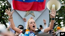 Lilian Tintori, wife of jailed opposition leader Leopoldo Lopez, speaks to her husband's supporters in Caracas, Venezuela, Sept. 11, 2015.