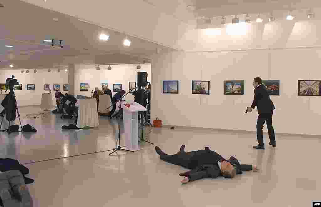 "Andrey Karlov (2ndR), the Russian ambassador to Ankara, lying on the floor after being shot by a gunman (R) during an attack during a public event in Ankara, Turkey. A gunman crying ""Aleppo"" and ""revenge"" shot Karlov while he was visiting an art exhibition in Ankara, witnesses and media reports said. The Turkish state-run Anadolu news agency said the gunman had been ""neutralised"" in a police operation, without giving further details."