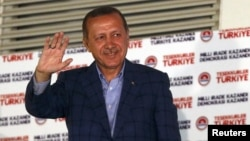 Turkey's Prime Minister Tayyip Erdogan waves to supporters as he celebrates his election victory in front of the party headquarters in Ankara August 10, 2014. Erdogan secured his place in history as Turkey's first directly elected president on Sunday, swe