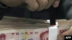 IMF nói đồng tiền của Trung Quốc 'ở dưới giá trị khá nhiều' và cần phải được tăng giá lại nhanh hơn