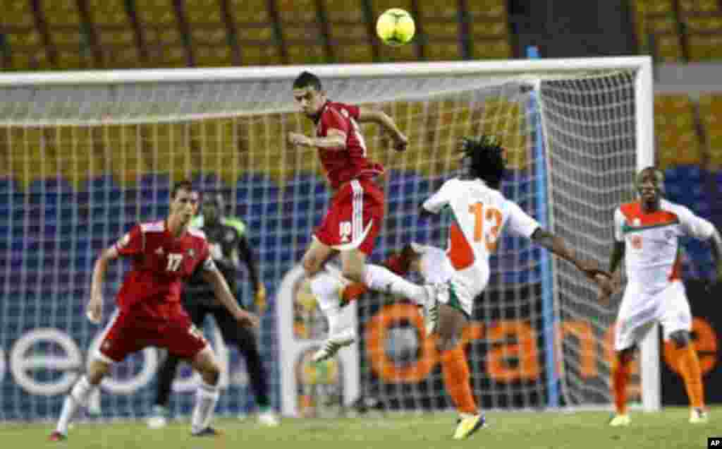 Morocco's Younes Belhanda (10) jumps for the ball against Niger players during their final African Cup of Nations Group C soccer match at the Stade De L'Amitie Stadium in Libreville, Gabon January 31, 2012.
