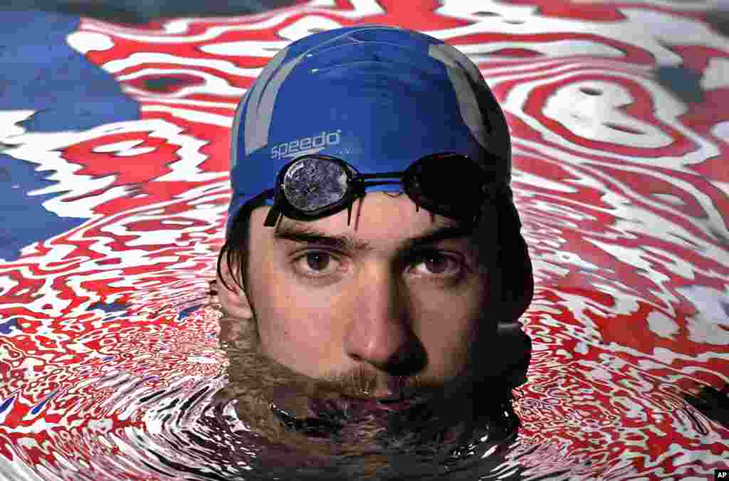 Olympic gold medalist Michael Phelps posing in the Belmont Plaza Olympic Pool in Long Beach, Calif. (Jan 2008 file photo)