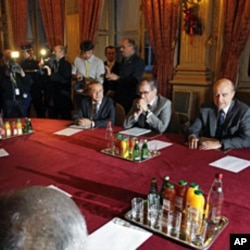 French Foreign Minister Alain Juppe (R) and members of the Turkish National Assembly are seen ahead of their meeting in Paris, December 20, 2011