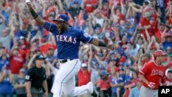 Texas Rangers' Hanser Alberto runs onto the field after the final out of the baseball game against the Los Angeles Angels in Arlington, Texas, Sunday, Oct. 4, 2015.