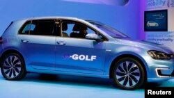 Volkswagen introduces the Volkswagen e-Golf electric car at the Los Angeles Auto Show.