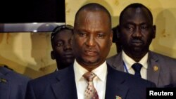 FILE - Taban Deng Gai, then-chief negotiator of the rebel group known as SPLA-IO, addresses a news conference after arriving in South Sudan's capital Juba.