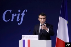 FILE - France's President Emmanuel Macron gives a speech during the 34rd annual dinner of the group CRIF, Representative Council of Jewish Institutions of France, in Paris, Feb. 20, 2019.