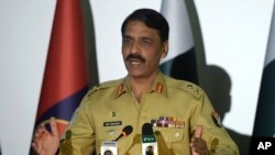 FILE - Pakistani military spokesman Major General Asif Ghafoor speaks to reporters in Rawalpindi, Pakistan, April 17, 2017. He said Oct. 14, 2017, that the rescue of a U.S.-Canadian family from Taliban activity offered a good opening in restoring mutual trust between Pakistan and the U.S.