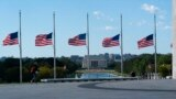 American flags around the Washington Monument are lowered to half-staff in honor of Colin Powell, former Joint Chiefs chairman and secretary of state, Oct. 18, 2021. Powell died from COVID-19 complications.
