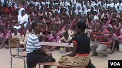 Girld children displaying their acting skills.