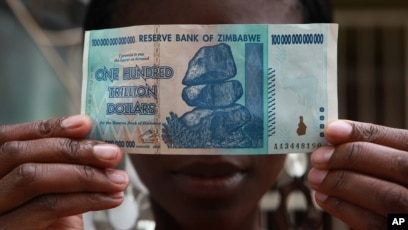 File A Woman Holds 100 Trillion Dollar Note In Harare The Highest
