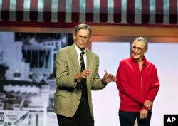 Jim Walton and Alice Walton speak during the Walmart shareholders' meeting in Fayetteville, Arkansas., June 1, 2012.
