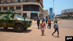 An armored vehicle of of the Congolese army, part of the Central African Multinational Force is parked in front of a bank in central Bangui on April 3, 2013.