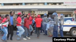 Mr. Morgan Tsvangirai abandoned his Bulawayo visit after police stormed his party headquarters in Harare.
